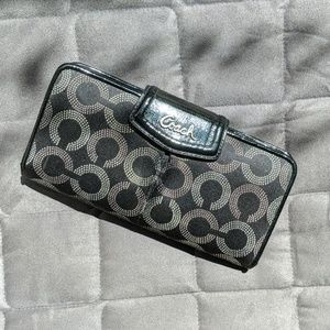 Black and silver Coach Clutch wallet